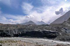 Massive black glacier beside the track