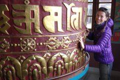 Miri checks out the prayer wheel